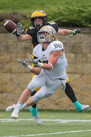 Gustavus wide receiver Jamison Beulke quickly becomes a defender to prevent Bethel's Dawson Brown from making an interception. Gustavus was held to 94 passing yards by the Bethel defense in their 24-3 loss. Photo by Jackson Forderer