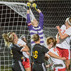 Mankato West goalie Mel Lobito (2) punches the ball out of the air during a Waconia corner kick. Waconia scored both of the their goals on corner kicks, but Lobitz's save late in the game sealed the Scarlets 3-2 victory. Photo by Jackson Forderer