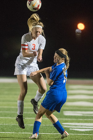 Mankato West's McKenna Buisman (3) takes a header over Waseca's Gabriela Rodriguez in the first half of Thursday's Section 2A championship game. Buisman scored in the 20th and 44th minute for the Scarlets. West won the game to gain a berth in the state tournament. Photo by Jackson Forderer