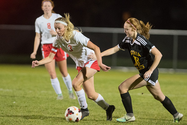 Mankato West's McKenna Buisman (3) is defended by Waconia's Sydney Stellick in the second half of Tuesday's Section 2A semifinal soccer game. Buisman scored the game-winning goal in the Scarlets' 3-2 win. Photo by Jackson Forderer