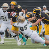 Gustavus' Cam Hufendick is tackled by Bethel's Jack Schultz during a punt return. The long return was called back due to a block in the back penalty. Photo by Jackson Forderer
