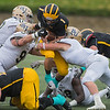 Gustavus' Hunter Johnson is tackled by three Bethel defenders during Saturday's game held at Hollingsworth field in St. Peter. The Gusties netted only 112 rushing yards and lost the MIAC conference game 24-3. Photo by Jackson Forderer