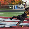 Solemn Haji of Mankato East misses connecting with a cross early in the first half against Worthington in the first half of the Section 2A boys soccer championship game played in New Prague on Thursday. The Cougars lost to Worthington 2-1. Photo by Jackson Forderer