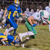 Maple River's Wyatt Simon tries to keep his balance after nearly being tackled by Le Sueur-Henderson's Burke Nesbit  in Wednesday's game played in Le Sueur. Photo by Jackson Forderer