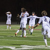 Mankato East teammates celebrate Adam Megard's long range goal that put the Cougars up 1-0 in the Section 2A final match. Photo by Jackson Forderer