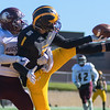 Gustavus' Brice Panning tries to complete a catch while being defended by Austin Kincade of Augsburg during Saturday's game played at Hollingsworth Field. Panning was unable to complete the catch, but Kincade was flagged for pass interference on the play. The Gusties rolled to a 42-0 victory. Photo by Jackson Forderer