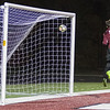 Worthington goal keeper Ben Lopez tries unsuccessfully to keep Mankato East's Adam Megard's shot from going into the upper right corner of the goal in the first half of the Section 2A final. Megard's long range shot put the Cougars up 1-0, but would be their only goal of the game. Photo by Jackson Forderer