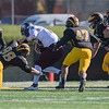 Gustavus defenders swarm Augsburg quarterback Chad Costello during Saturday;s MIAC conference game. Photo by Jackson Forderer