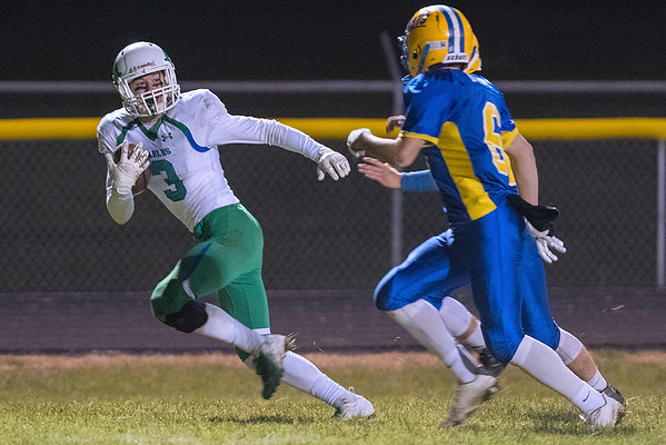 Maple River's Seth Swehla breaks away from two Le Suer-Henderson defenders during Wednesday night's game. Photo by Jackson Forderer