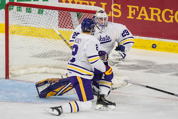 Minnesota State's Dryden McKay fends off a shot on goal from a Boston University player in the second period of Saturday's game. Photo by Jackson Forderer