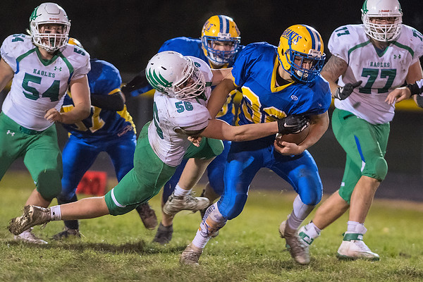 Maple River's Nathan Trio (left) tackles Le Sueur-Henderson's Gabe Webster in Wednesday's game. Maple River won the game 50-14. Photo by Jackson Forderer