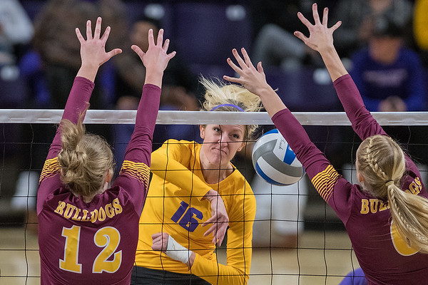 Minnesota State's Anissa Janzig (middle) hits the ball past the outstretched arms of Abby Thor (12) and Hannah Meyer (right) of the University of Minnesota-Duluth. The Mavericks lost to the seventh-ranked Bulldogs in three games. Photo by Jackson Forderer