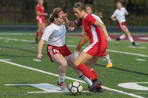 Ashley Gustavson (right) of Mankato West dribbles past Fairmont's Cora Kueker during Thursday's Section 2A championship game. Photo by Jackson Forderer