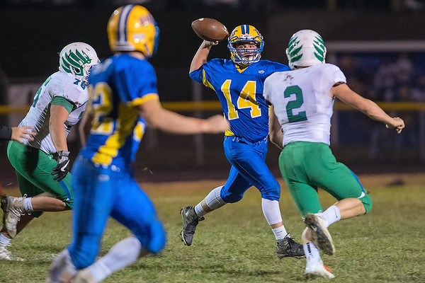 Le Sueur-Henderson's Zach Berndt (14) looks for an open receiver downfield in Wednesday's game against Maple river. Photo by Jackson Forderer
