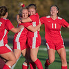 From left, Hailey Kopischke, Kristen Rasmussen, Hope Walz and Emma Doell celebrate after Rasmussen's goal in the first half against Fairmont. Rasmussen scored the Scarlets' second goal with a header from a corner kick from Rachel Luedtke. Photo by Jackson Forderer