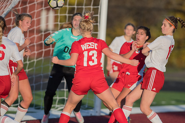 Mankato West's Kristen Rasmussen heads the ball into the net off of a corner kick for the Scarlets second goal against Fairmont in the Section 2A championship game. Photo by Jackson Forderer
