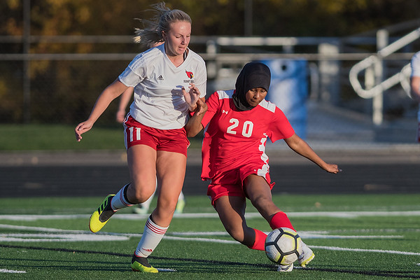Mankato West's Monera McMahon takes a shot on goal while being defended by Fairmont's Lily Hohensee in the Section 2A final game played in New Prague on Thursday. McMahon was one of seven forwards who kept relentless offensive pressure on the Cardinals in their 3-0 victory. Photo by Jackson Forderer