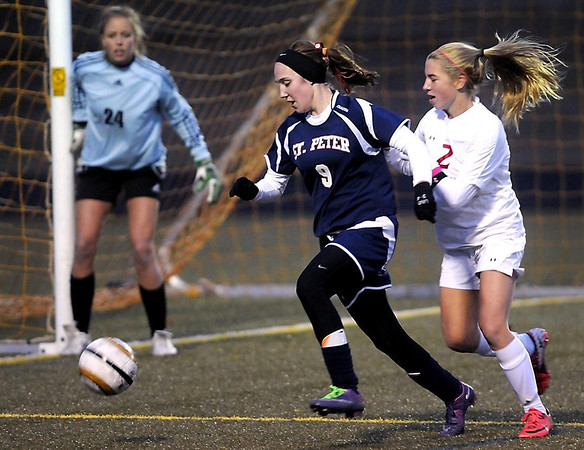 Benilde-St. Margaret's goalie Annie Michels and teammate Emily Schmitz keep an eye on St. Peter's Emily Brinkman during their State Class A quarterfinal soccer match Friday at Park High School in Cottage Grove.