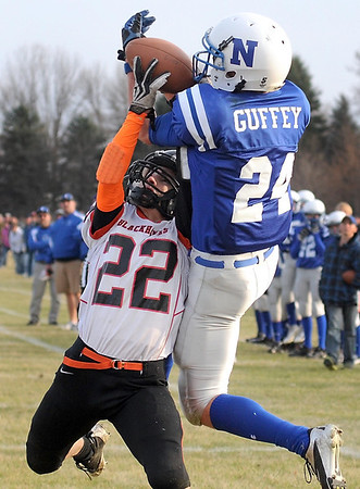 Madelia's Byron Forstner breaks up a pass in the end zone intended for Nicollet's Evan Guffey during the first half Saturday in Nicollet.