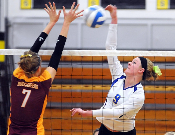Blue Earth Area's Krista Hassing leaps to block a hit by Le Sueur-Henderson's Jessica Thelemann during their match Tuesday at the Mankato East gym.