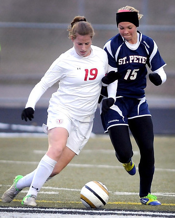 Benilde-St. Margaret's midfielder Kelly Pannek and St. Peter's Halla Dontje Lindell collide while going for the ball during their State Class A quarterfinal soccer match Friday at Park High School in Cottage Grove.