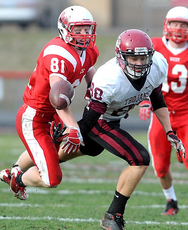 Mankato West's Will Claussen (81) knocks away a pass intended for New Prague's Jason Kazlauskas during the first half of Saturday's Section 2AAAAA semifinal game at Todnem Field.
