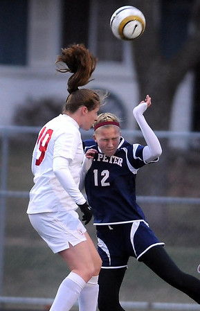 Benilde-St. Margaret's player Kelly Pannek and St. Peter's Marta Springer leap for the ball during their State Class A quarterfinal socer match Friday at Park High School in Cottage Grove.