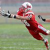 Mankato West's Connor Watts dives for a pass during the first half Saturday at Todnem Field.