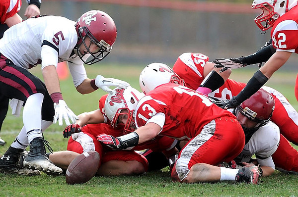 New Prague's Nick Johnson and Mankato West's Alex Knutson (13) reach for a loose ball during the first half of Saturday's Section 2AAAAA semifinal game at Todnem Field.