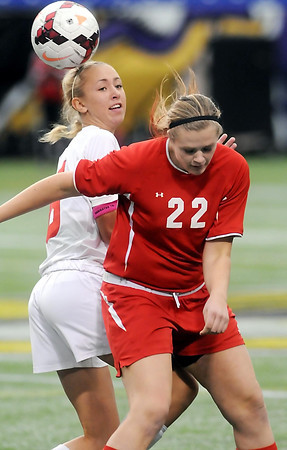 John Cross<br /> Mankato West's Bre Black and a Benilde-St. Margaret's player battle for the ball in State Class A semifinal action at the Metrodome on Monday.