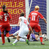 John Cross<br /> The ball slices just inside the goal, getting past Mankato West goalie Katie Lauer for Benilde-St. Margaret's first goal during State Class A semifinal action at the Metrodome on Monday.