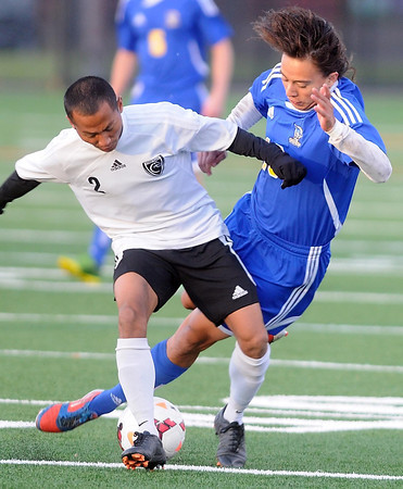 Pat Christman<br /> Waseca's Cesar Gallegos falls as St. Paul Como Park's Seik Seik controls the ball during the first half of their State Class A quarerfinal game Friday in St. Louis Park.