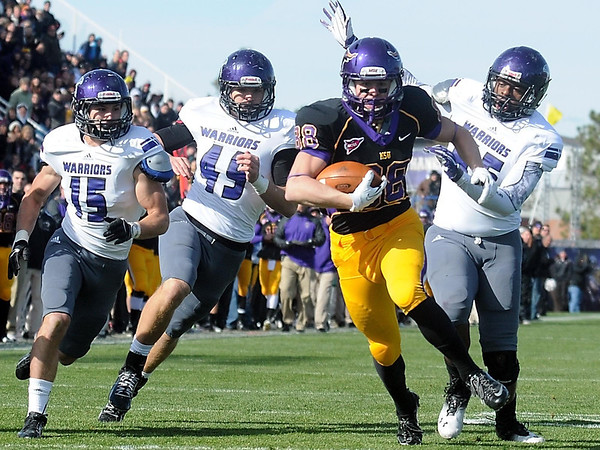 Pat Christman<br /> Minnesota State's Austin Rieder races in for a touchdown ahead of a trio of Winona State defenders Saturday.
