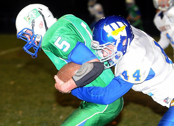 Pat Christman<br /> Maple River running back Aaron Trio fights for extra yards as Windom Area's Andrew Larson tries to bring him down during the first half Tuesday in Mapleton.