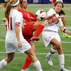 Mankato West's Taylor Marx is sandwiched between Benidle-St. Margaret's defenders Grace Coughlin (11) and Katie Oppenheimer during State Class A semifinal action at the Metrodome on Monday.