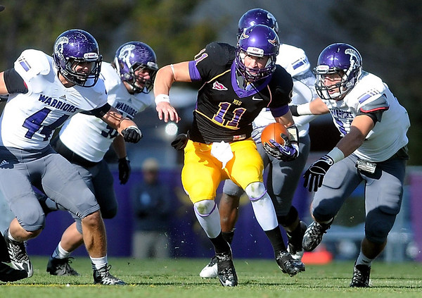 Pat Christman<br /> Minnesota State quarterback Jon Wolf finds some running room during the first half against Winona State Saturday.