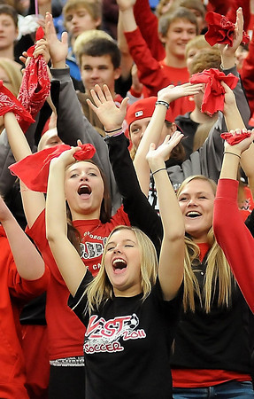 John Cross<br /> Mankato West fans cheer for the girls' soccer team which was making its first appearance in the Metrodome in the Girls Class A State Tournament on Monday. The Scarlets were defeated by Benidle-St. Margaret's in a semifinal game, 5-1.