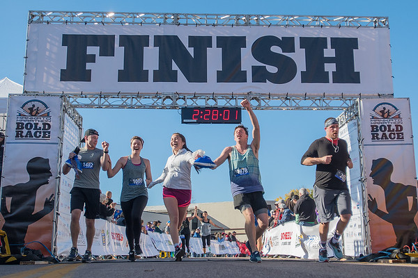 Runners in the Mankato half marathon cross the finish line Sunday. Photo by Jackson Forderer