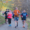 Runners in the Mankato half marathon run along the trail behind Mt. Kato on their way to the finish line on Sunday. Photo by Jackson Forderer