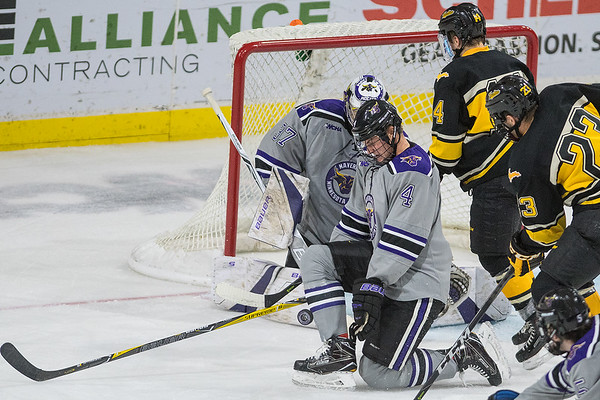 Minnesota State's Clint Lewis (4) kneels to block a puck against Michigan Tech during Friday's game. The Mavericks won the game 3-1. Photo by Jackson Forderer