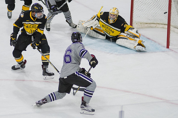 Minnesota State's Reggie Lutz watches his first goal as a Maverick go past Michigan Tech's goalie Patrick Munson in the first period. MSU defeated Michigan Tech 5-3 after being down 2-3 to start the third period. Photo by Jackson Forderer