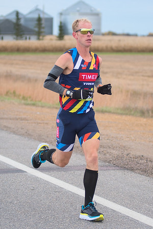 Daniel Bretscher runs in the full Mankato Marathon along Monks Ave. Photo by Jackson Forderer