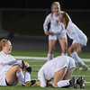 Hope Walz (left) and McKenna Buisman (3) of Mankato West cry after losing to North Branch 2-1 in the girls state quarterfinal game played in Prior Lake on Wednesday. North Branch scored two goals in the second half to defeat the Scarlets. Photo by Jackson Forderer