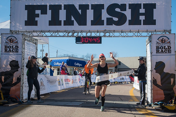 Monica Dorn crosses the finish line as the overall winner of the Mankato full marathon female division. Photo by Jackson Forderer