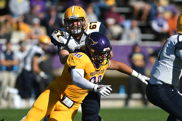 Minnesota State's Chance Bowen (98) goes after Augustana's quarterback in a game played on Oct. 7. Photo by Jackson Forderer