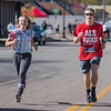 Grace Keller (left), 12, runs with her brother Tyler Keller along the last stretch of the full marathon on Front St. Photo by Jackson Forderer
