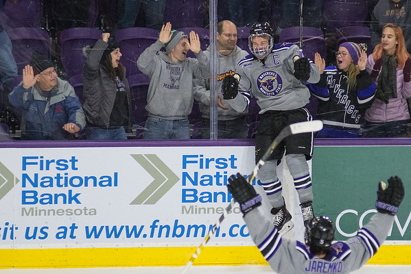 Minnesota State's Brad McClure jumps against the glass after scoring a goal against Michigan Tech Friday at the Verizon Center. The Mavericks won the game 3-1 with two late goals. Photo by Jackson Forderer