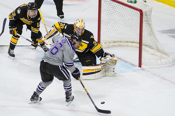 Minnesota State's Josh French looks to score on Michigan Tech goalie Patrick Munson in the third period of Friday's game played at the Verizon Center. The Mavericks defeated the Huskies 3-1 with late goals from Brad McLure and Zeb Knutson. Photo by Jackson Forderer