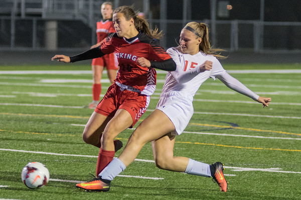 Mankato West's Katie Roberts (15) takes a shot on goal past North Branch defender Abigail Johnson in  the first half of play in  the state quarterfinal match. Photo by Jackson Forderer