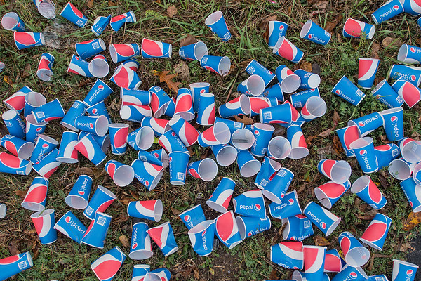 Discarded cups line the grass at a water station behind Mt. Kato along the half and full marathon routes. Photo by Jackson Forderer